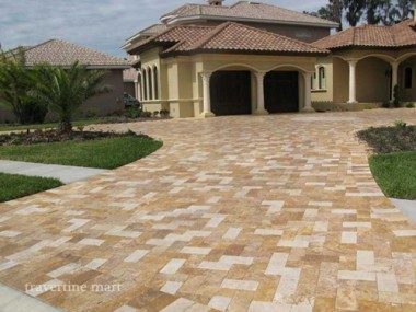 Install travertine pavers on top of concrete to create a lovely outdoor living space.