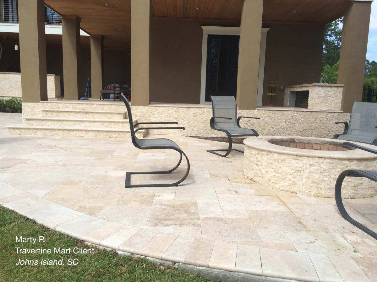 French Pattern Ivory Tumbled Travertine Pavers around a pool area