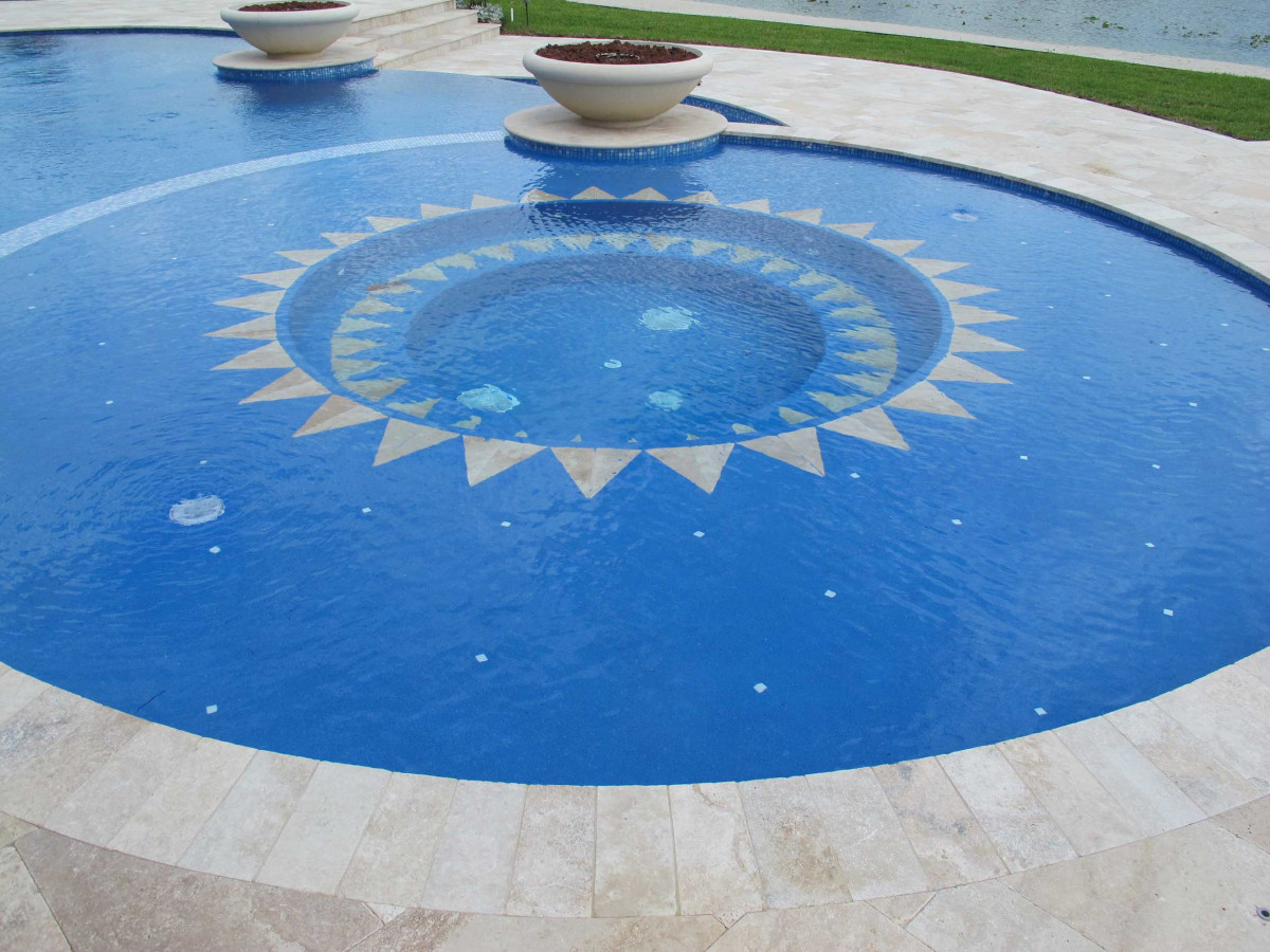 6x12 Ivory Swirl Paver as pool coping surrounding a pool