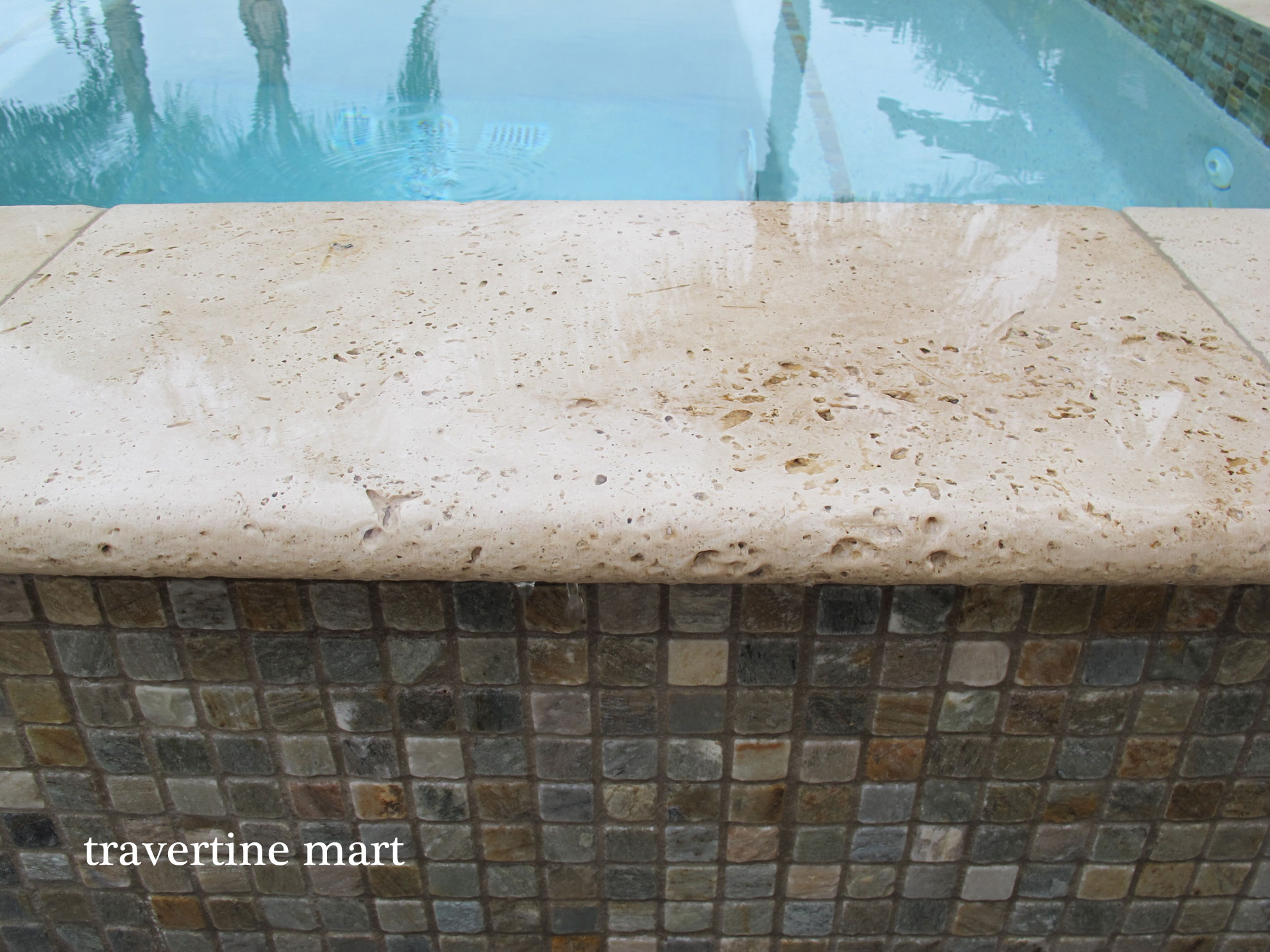 Travertine pavers and salt water erosion for Pool design regrets
