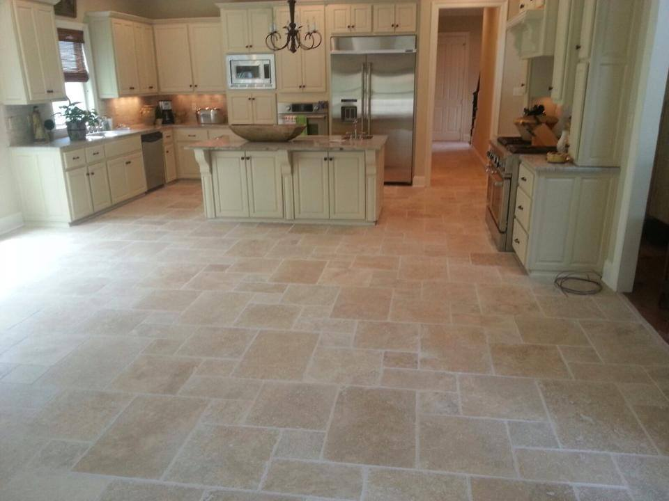 French Pattern Ivory Swirl Tumbled Travertine Tiles on a kitchen floor