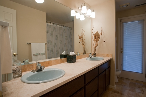 A luxurious guest bathroom with travertine tile will really impress your home's visitors!