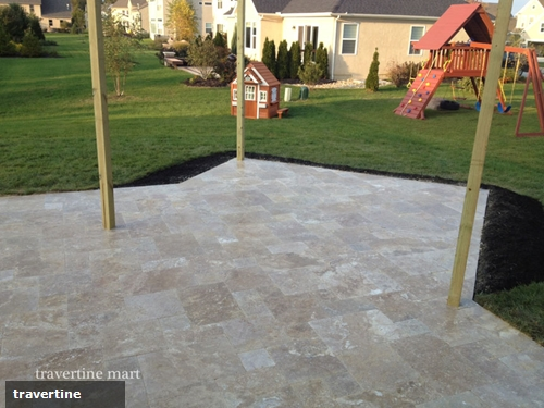 From the garden to the patio, travertine pavers will elevate your backyard