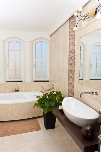 Small bathrooms can still make a big impact with the right decor elements - like travertine tile!