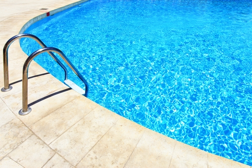 Transform your travertine pool area into a neighborhood party spot