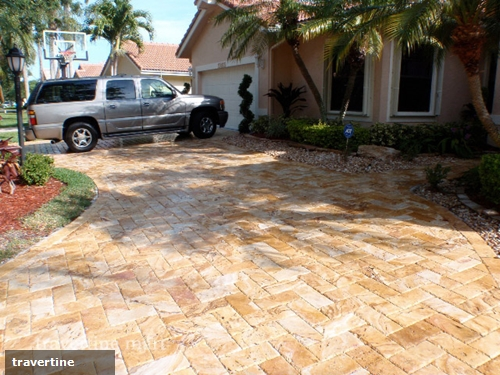 Why are travertine pavers ideal for a driveway?